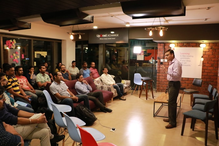 Dr. Pavan Soni introducing Product Management to attendees of Panel Discussion at UpGRad Xchange